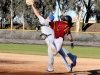 LMC and Modesto Baseball game at LMC. LMC player #8 Jason Kreske runs to first base and makes it because Modesto player misses catch. Cathie Lawrence