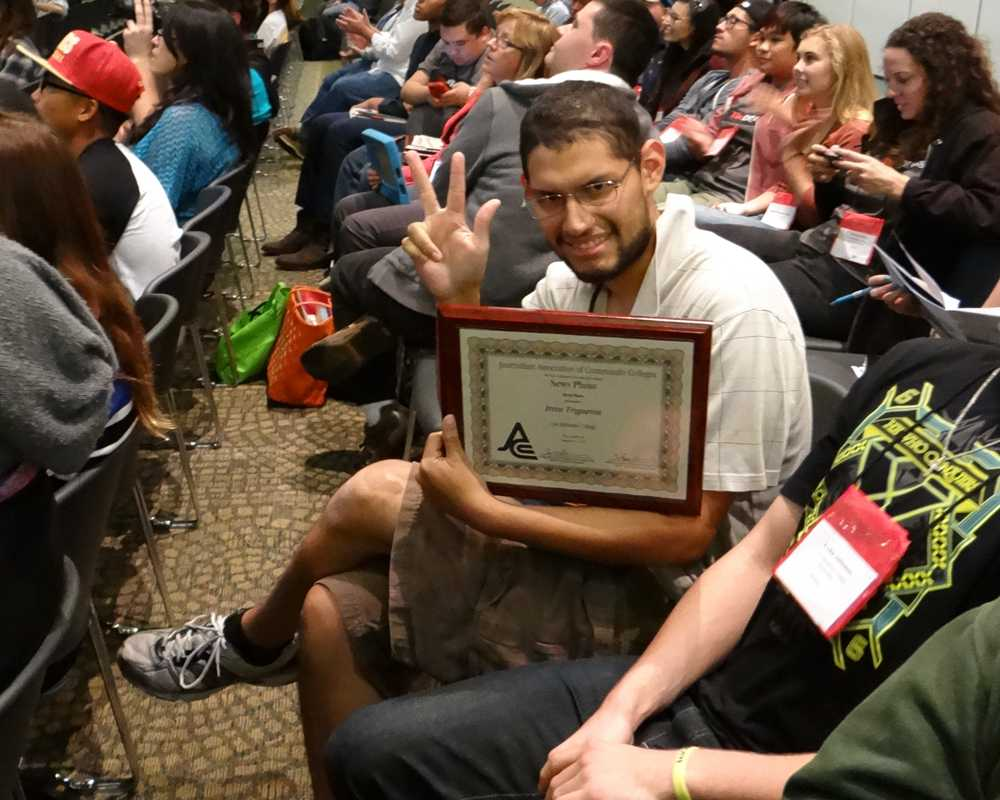 Photo+Editor+Irvin+Trigueros+proudly+displaying+his+First+place+award+for+On-The-Spot+Newsphoto+from+the+JACC.