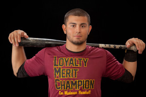 "Kelly Starnes sports a shirt that reads ""Loyalty Merit Champions,"" three words his team lives by. It is also an acronym for LMC."