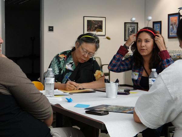Reiko Kobuta and Maria Martinez wear antennae ears as part of an art activity.