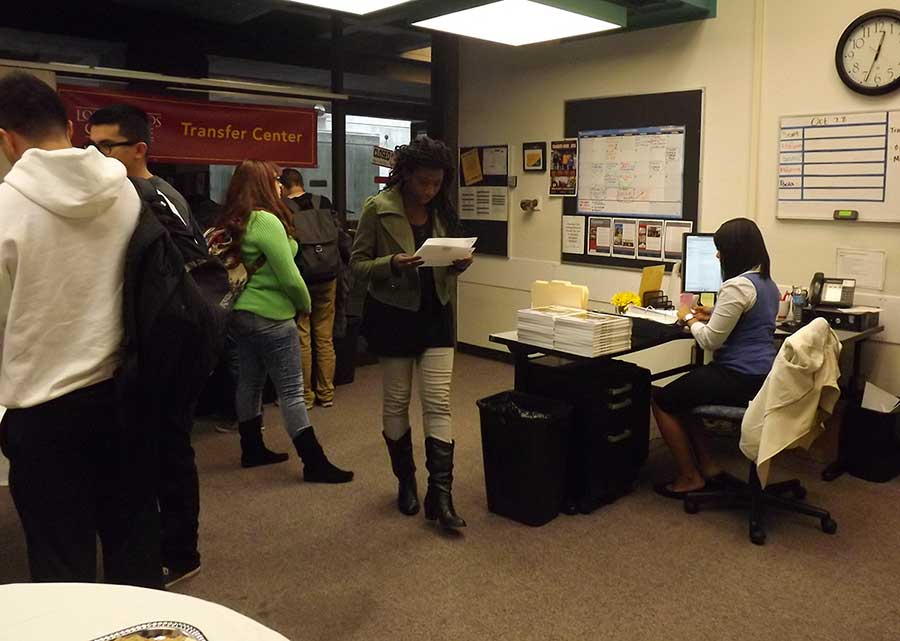 The Open House event during Transfer Week in the Transfer Center shows students acquiring information on four-year colleges.