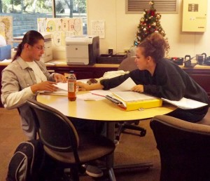 Ricardo Black and Zinah Abraha help each other study in the Honors Center.