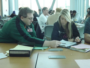 Professor Jeff Cohen and Lauren Marner go over mathematical strategies in the Mathematics Lab.