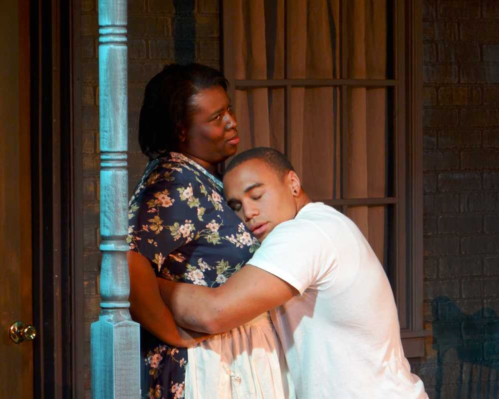 Mario Castillo embraces Arionna White during a performance of