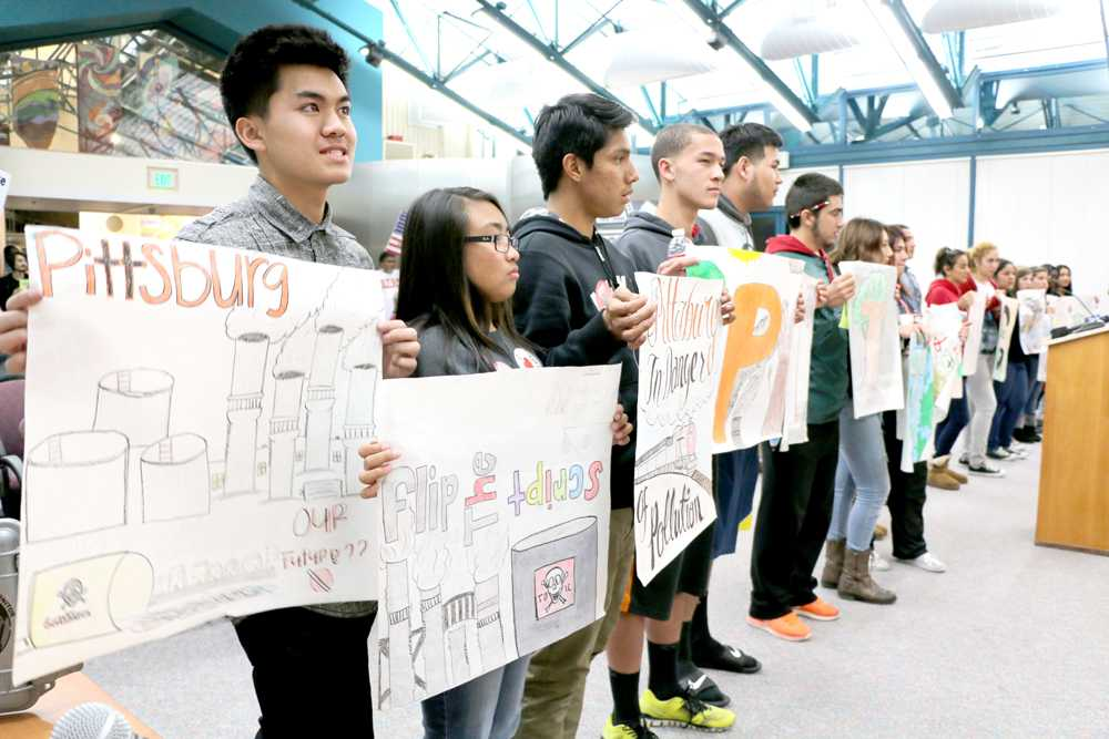 Pittsburg High School students show their distaste for the prosposed project involving volatile oil mixtures being imported into an empty compound near the waterfront in Pittsburg that has been vacant for 15 years.