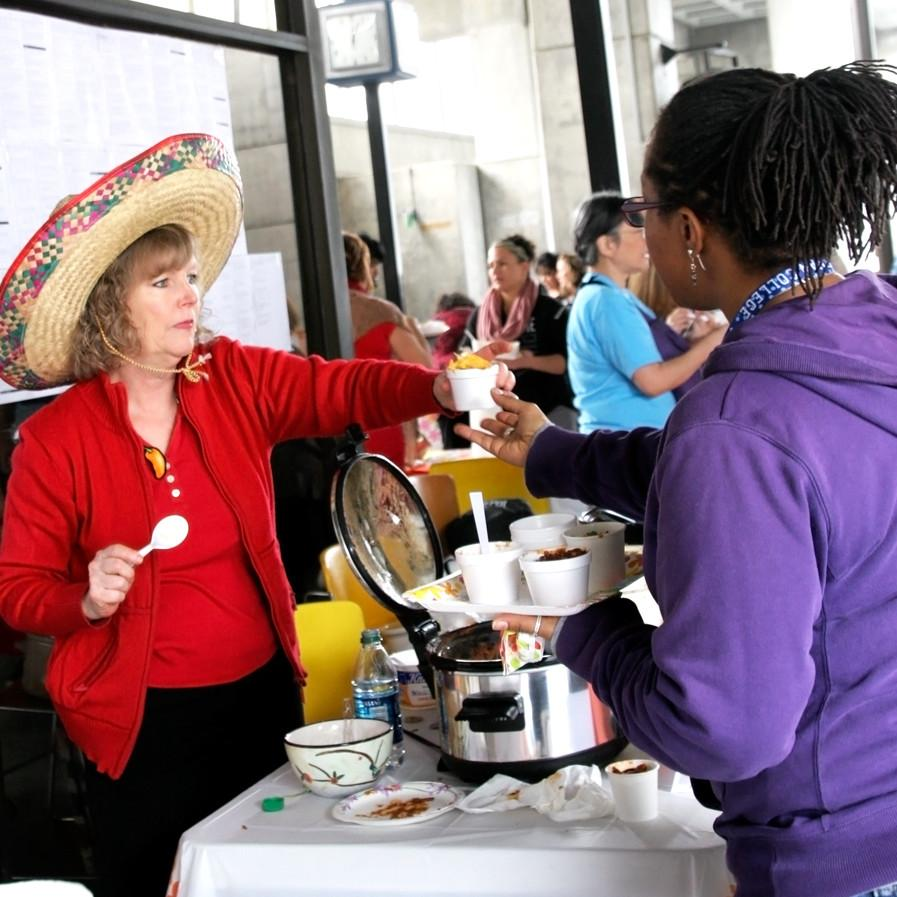 HR+Rep.+Kathy+Griffin+serves+LMCAS+Advisor+Demetria+Lawrence+her+%22Divine+Swine%27+chili.+March+5%2C+2014.+Photo+By+Cathie+Lawrence.