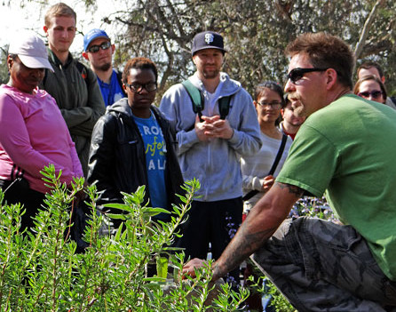 Instructional Assistant Mark Asher provides a nature lecture on plant life to Ronald Gallin's Biology Science 7 class in the Outdoor Living Laboratory at the Nature Preserve Tuesday, Feb. 25.