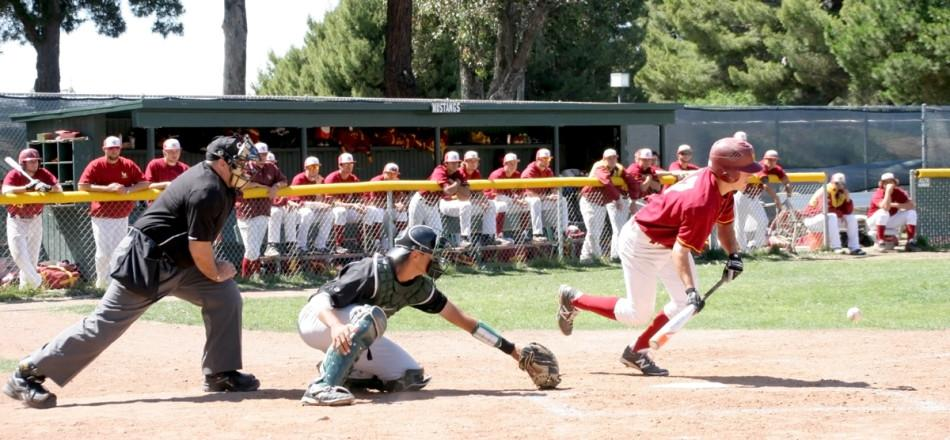 Ben Polansky drops down a sacrifice bunt. He won Player of the Week for the complete game shutout of Mendocino April 12.