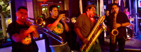 Aaron Craig, Javier Munoz, Marcus Bettencourt and Isaac Fematt play their horns during their show on Oct. 18, 2013.
