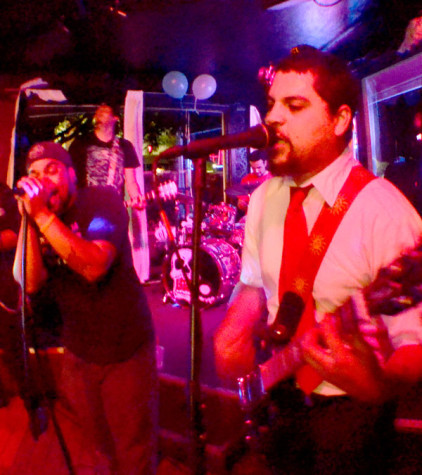 Terrance Williams and Christian Munoz rock out with their band, Day Labor, during their show on Oct. 18, 2013 at the Mutiny in Antioch.