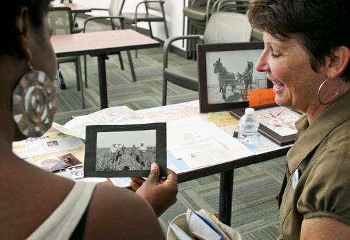 Debora Van Eckhardt shares her family genealogy photos with Aisha Hall during the Human Library event in the Library room L109. on April 15, 2014 at LMC in Pittsburg, Calif.