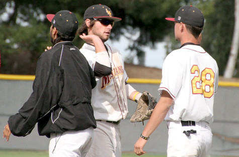 Shortstop Ryan Lacy and outfielder Cameron Darling share a high five after the final game of the season, a 12-0 win over Laney College.