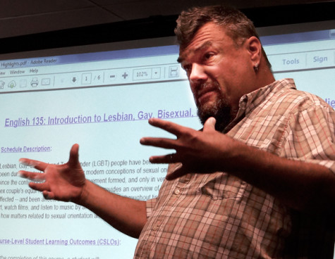 Professor Jeffrey Mitchell Matthews speaks to a small audience about what to expect in his upcoming LGBT course.