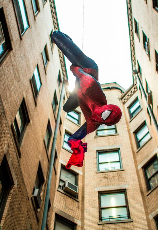 Andrew Garfield reprises his role as Spider-Man and hangs from his web in the first scene.