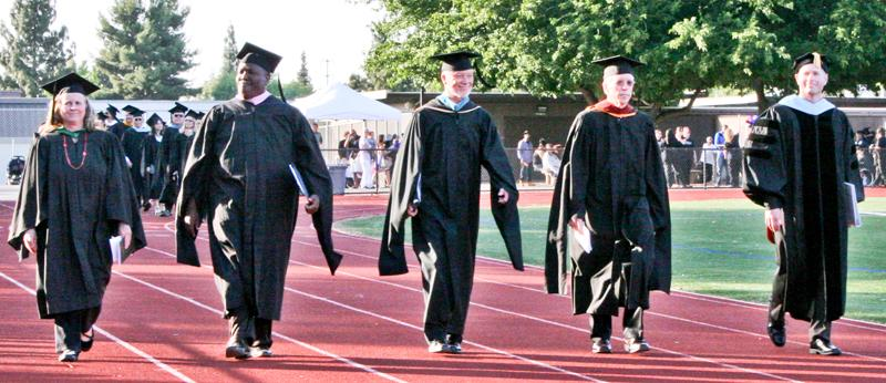 The+walk++for+the+graduates+begins+with++the+college%27s+leaders%2C++%28left-right%29++LMC+Classified+Senate+President+Linda+Kohler%2C+LMC+President+Bob+Kratochvil%2C+District+Board+Trustee+Greg+Enholm+and+LMC+Vice+President+Kevin+Horan+on+May+21%2C2014.+