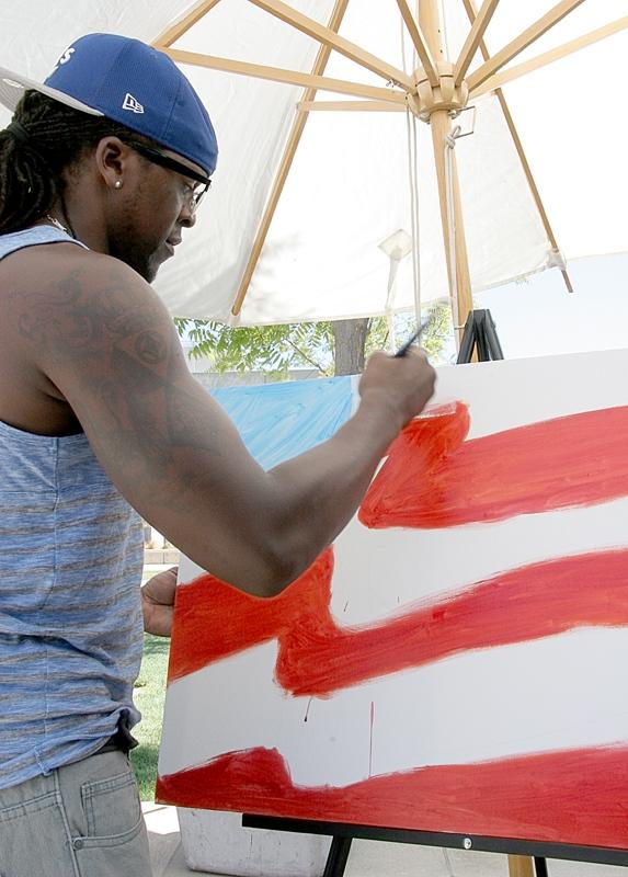 Artist Bobby Arte paints the American flag in the Pittsburg Campus outdoor quad during Constitution Day.