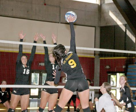 LMC Player Anna Vega (9) hits ball over the net in a match between LMC and Butte College. The results of the Mustang Classic saw Butte defeat LMC 3-1 and 3-0 and LMC beating Merced 3-2.