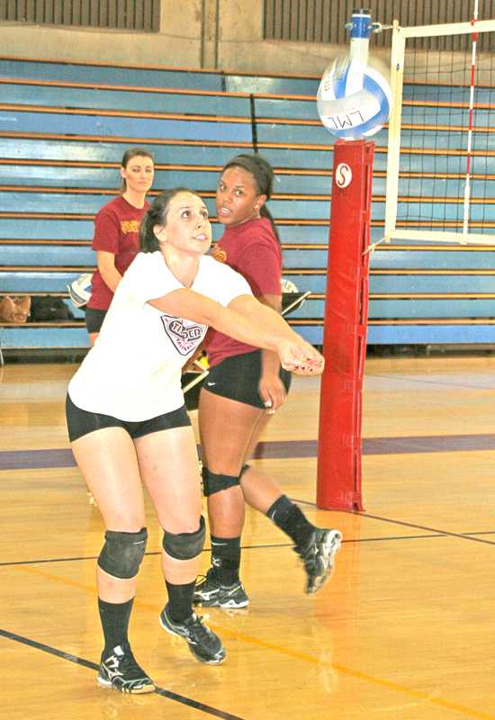 Anna Vega (front) and Taylor Scriven run volley drills while assistant coach Sandra Foster (back) watches.