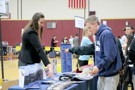 Student Andrew Olender talks to Alexandra Ball from San Diego State University during College Night, Oct. 27 in the Gym.