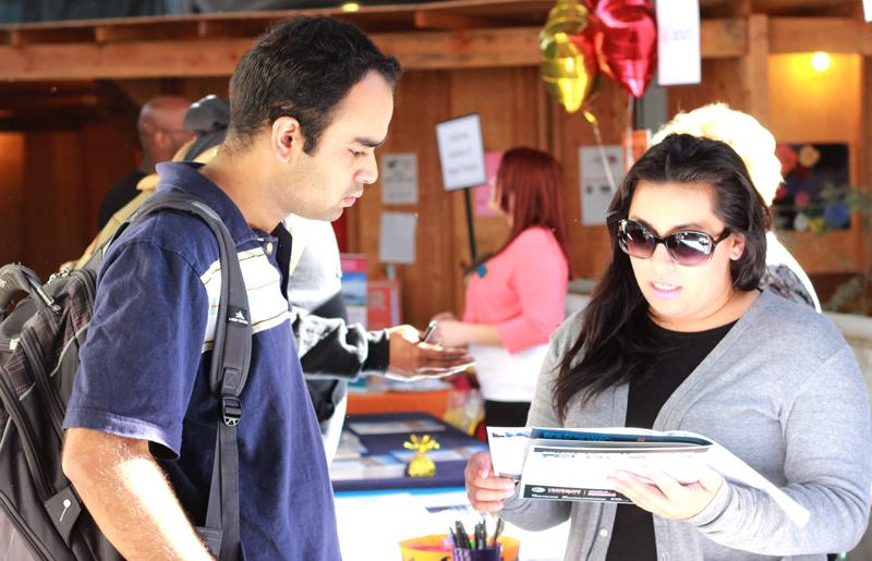 Student Kunal Khanna speaks with Lucie Lombera, a representative from CSU East Bay during the LMC Transfer Day event Monday, Oct. 27 on Level 3 of the College Complex.