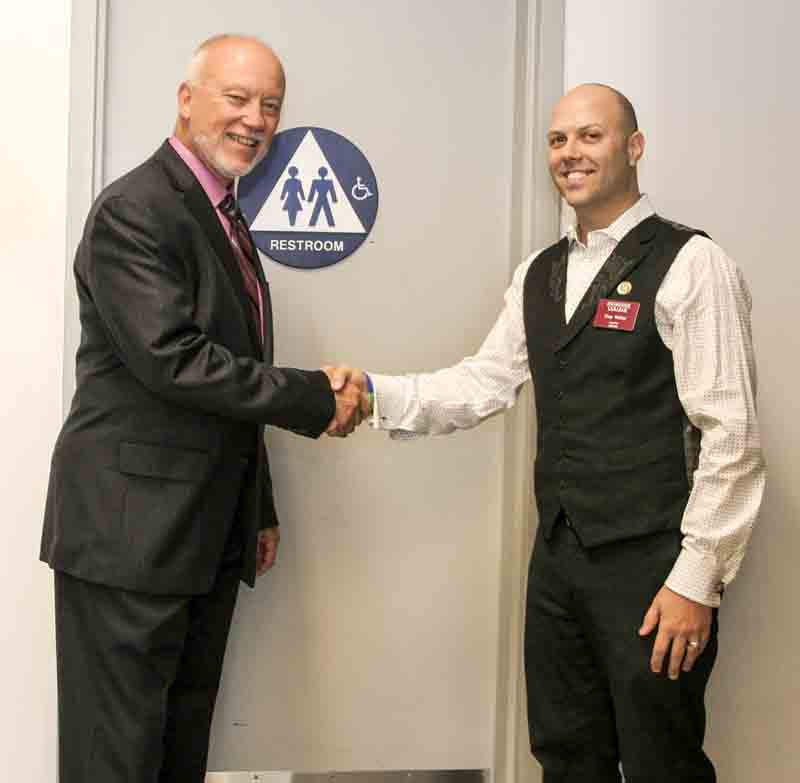 LMC President Bob Kratochvil and LMCAS President Gary Walker commemorate the designation of the first gender-neutral bathroom.