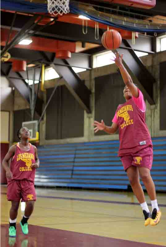 Mustangs basketball is preparing for the 2014-15 season looking to build off of 2013-14 play. Gabrielle Worley waits for the rebound as Qunaisha Hall jumps for the layup during drills.