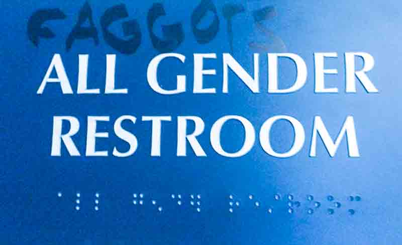 s The sign adorning the wall adjacent to the gender neutral bathrooms was vandalized   with a homophobic slur.