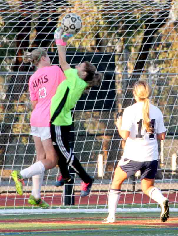 Mustangs Randi Strain collides with 49ers goalkeeper Aracely Garcia while attempting to head in the ball for a goal.