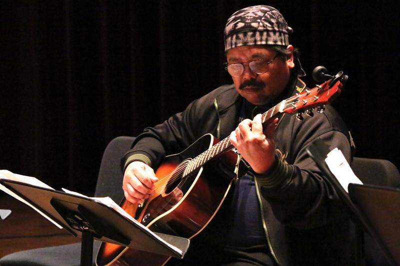 Singer and guitarist Zeke Nuez performs on acoustic guitar in the Recital Hall during the Guitar Recital Dec. 3.