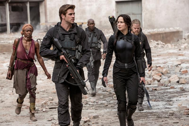 Liam+Hemsworth+%28Gale+Hawthorne%29+and+Jennifer+Lawrence+%28Katniss+Everdeen%29+during+a+scene+in+%E2%80%9CThe+Hunger+Games%3A+Mockingjay+%E2%80%91+Part+1.%E2%80%9D+