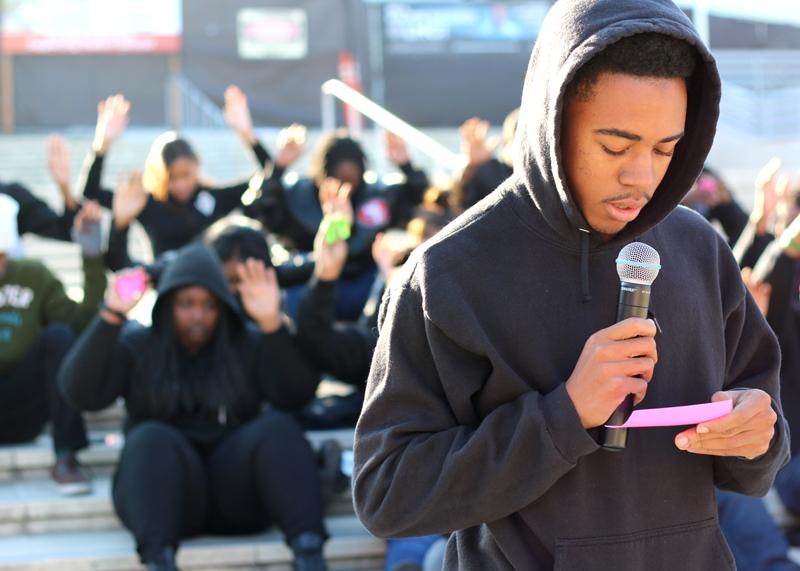 Jamari Evers-Threatt reads the name of a victim of police brutality.