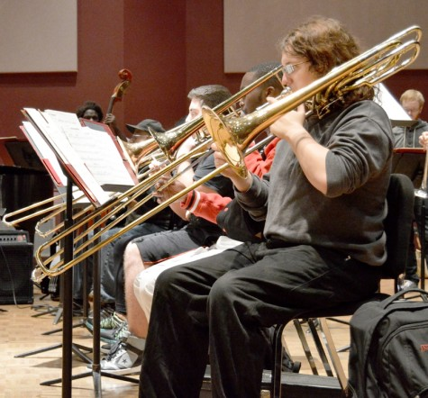 Student musicians diligently rehearse the possible selections for concerts during this semester. Trombonist Shawn Hancock provides harmonies with other members of the brass section.