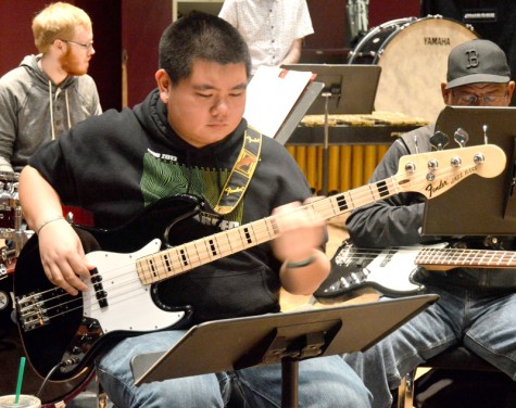 Returning bassist Emile Conception lays down the foundation for a tune with a smooth walking bass line.