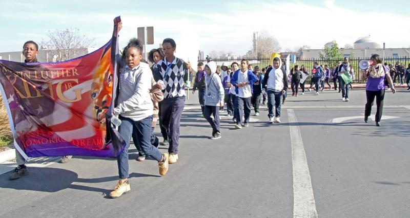 More than 700 students of Martin Luther King Jr. Junior High School marched to and from the Maya Cinemas in Pittsburg. Along the way, they carried a banner depicting Martin Luther King Jr. and chanted together.