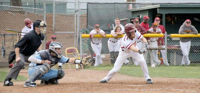 LMC+rightfielder+Ty+Nielson+lays+down+a+sacrifice+bunt+in+the+bottom+of+the+sixth+inning+that+led+to+two+unearned+runs+scoring+to+tie+up+the+game.