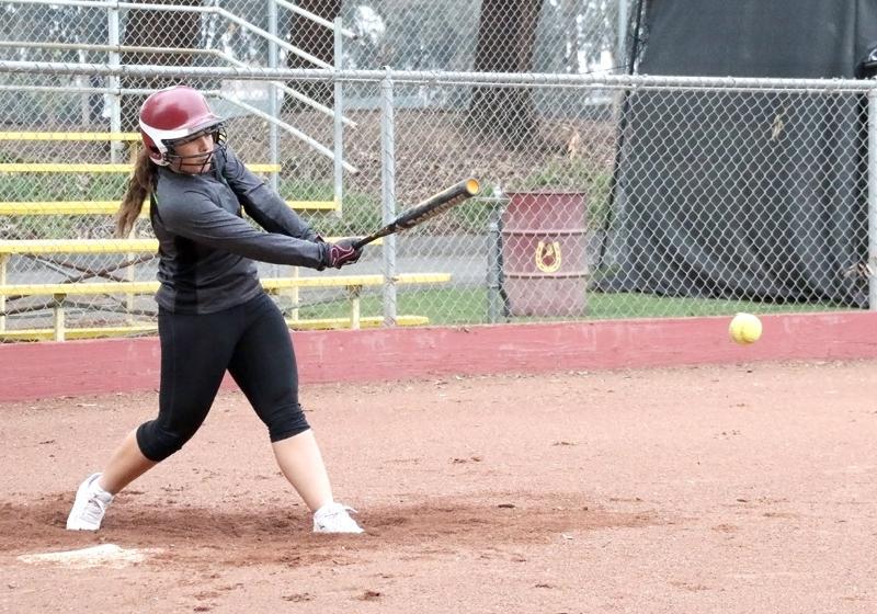 As softball prepares for the upcoming season  Jasmina Cross works on her swing during batting practice.