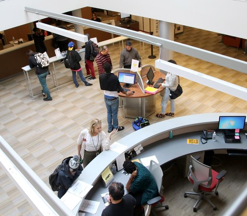 A view from the second floor as students use the new Student Services Center facilities.