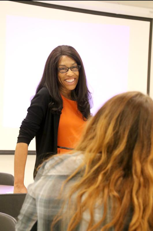 Political Science Professor Iris Archuleta enjoys conversing with her students. She loves to challenge students to push through their academic boundaries.