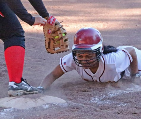 The 2015 softball season kicked off with a sweep of a doubleheader over San Francisco City College on Saturday, Jan. 31 by a combined score of 31-2. The two wins were a full team effort as multiple players contributed on offense and pitcher Jenna Leavitt pitched a complete game shut out in the first game and two innings allowing only one run in the second game. Outfielder Antianna Johnson slides into third on a pick-off attempt during the win over the Rams.