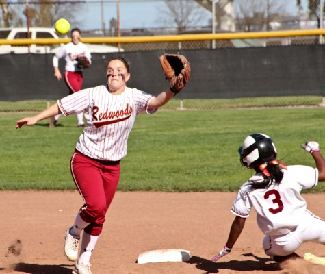 LMC's Gabrielle Worley slides safely to second after a missed opportunity by Redwoods' Kirsha White.