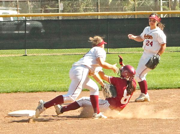 Shortstop Lyrica Langlois tags out Redwoods' Morgan Psalmonds as she tries for second base.