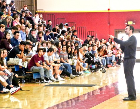 Drama instructor Nick Garcia speaks to high school students inside the Gymnasium during Senior Saturday, April 18.
