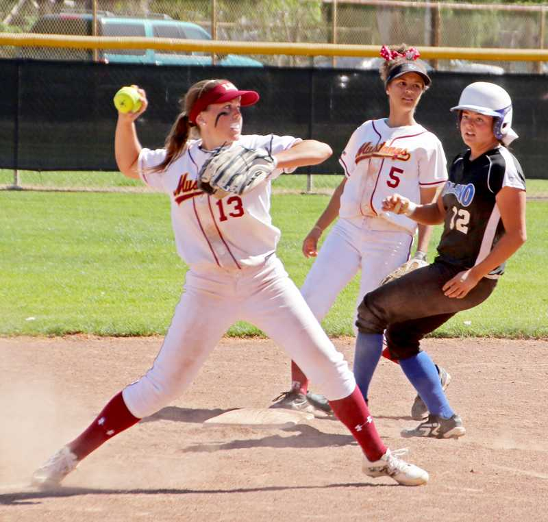 Shortstop Lyrica Langlois gears up to throw the runner out at first base during a loss to Solano College Thursday, March 19.