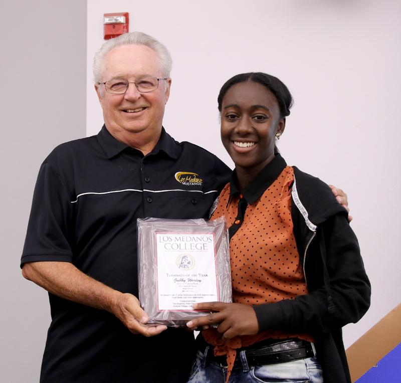 Gabrielle Worley and Tim Rognlien as Roglien gives Worley her award as team mate of the year.