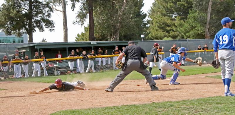 The Mustangs score a first inning run during a 2-1 victory over the Solano Falcons March 21.