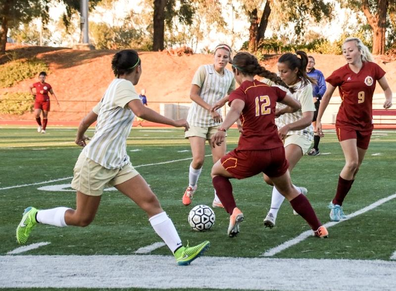 San Joaquin Delta players Marissa Galvin, Jessica Hufford and Estela Rodriguez try to pry the ball away from LMC's Lynette Chavoya and Maggie O'Shea-Friedman during an 8-0 preseason loss Tuesday, Sept. 1