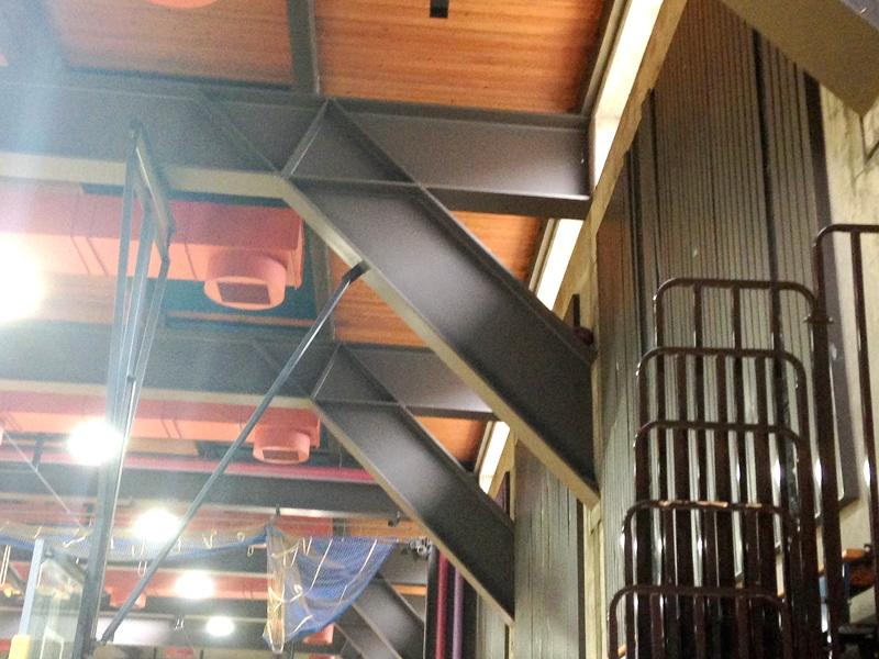 Beams with a lead-based paint cross the Gymnasium ceiling.