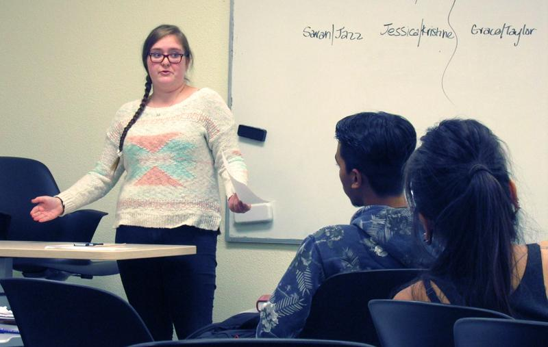 The Debate Team hones their skills Oct. 7 during a practice session. The team scrimmaged on the topic of whether or not a post-gender society is preferrable over the current status quo. Team advised by Marie Arcidiacono. (Long braid is Sarah Zamjahn)
