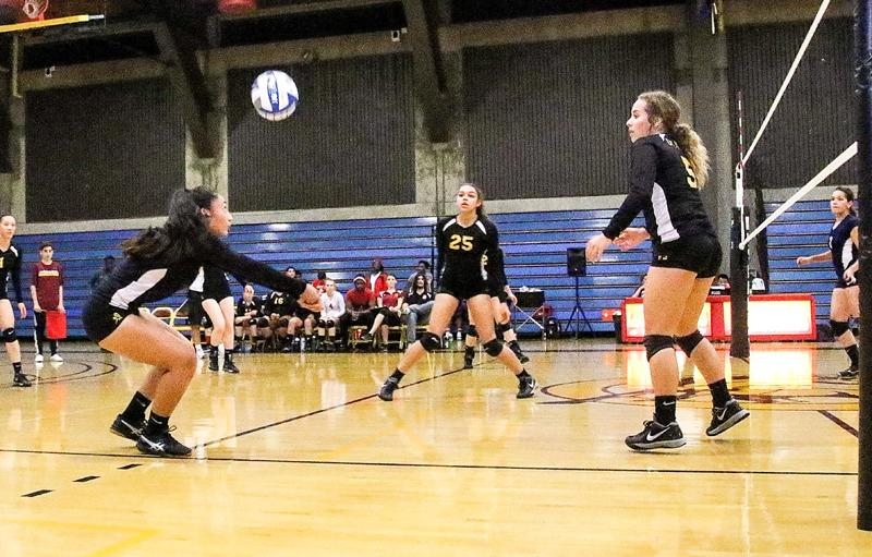 Volleyball players Janessa Seei, Kila Stevens and Aubree Dejesus during the Wednesday, Oct. 28 win against Contra Costa College.