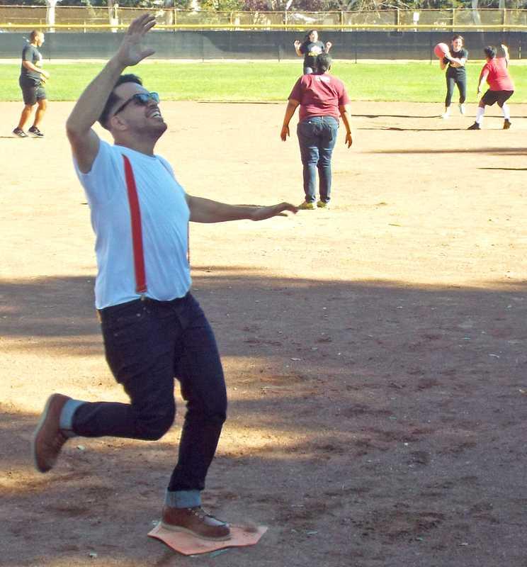 LMC Alternate Media Specialist Kenny Purizaga celebrates scoring a run during the first Intramural Kickball League game.
